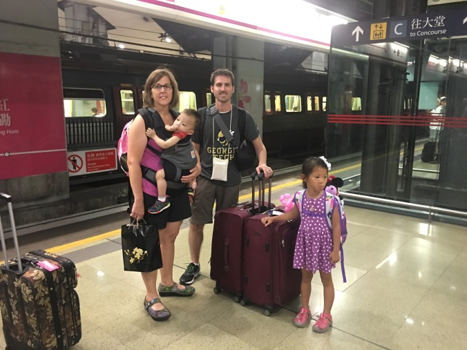 Navigating the train station in Kowloon